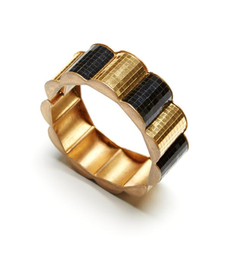 FD Gallery's Boivin yellow gold bangle circa 1935, featuring a hidden lock closure and black scallop detailing. $78,571 at Moda Operandi.