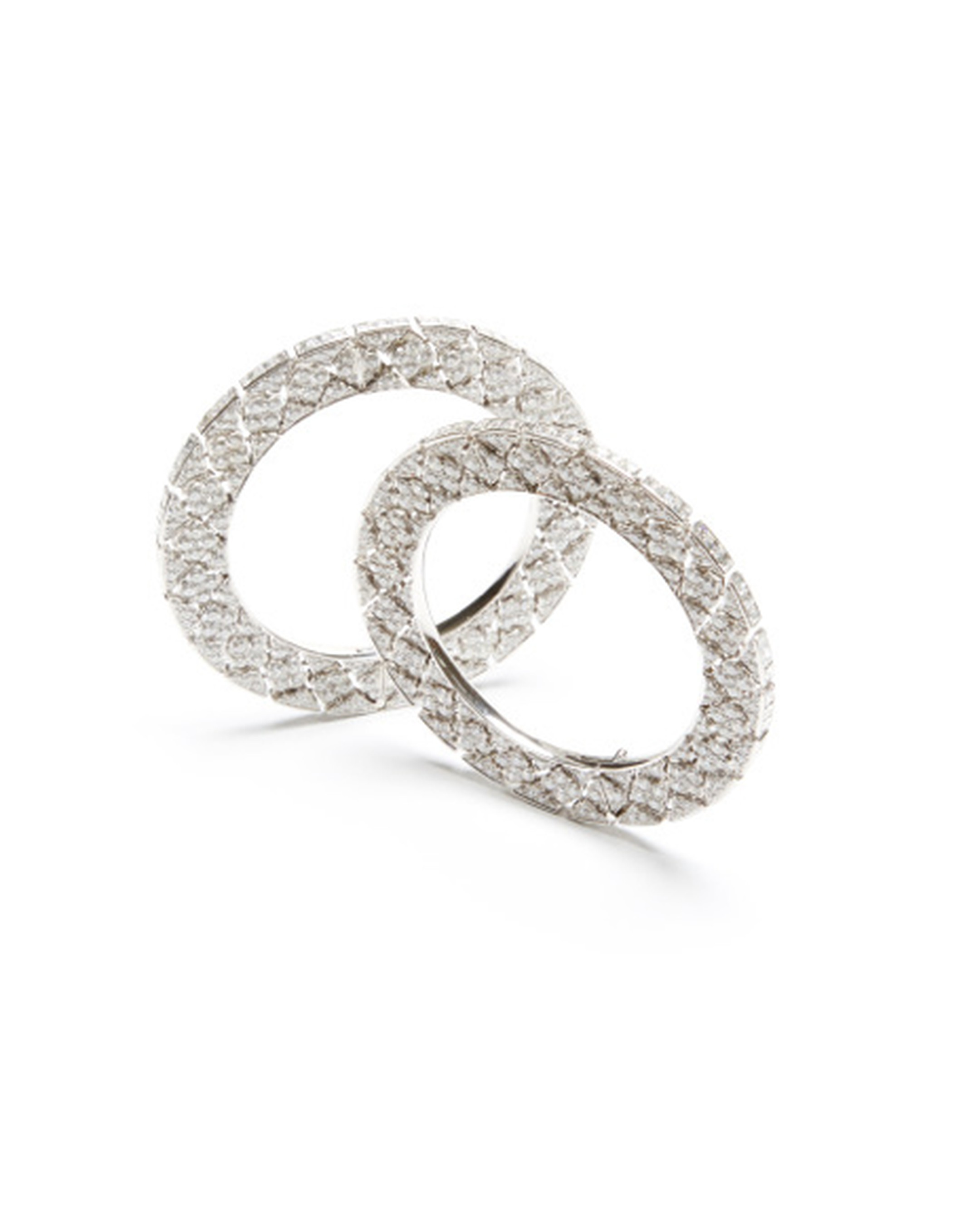Pair of diamond bangles by famed Indian jeweller Bhagat set with 50.66ct diamonds and an additional 21.12ct of carré-cut diamonds. $480,000 at Moda Operandi.