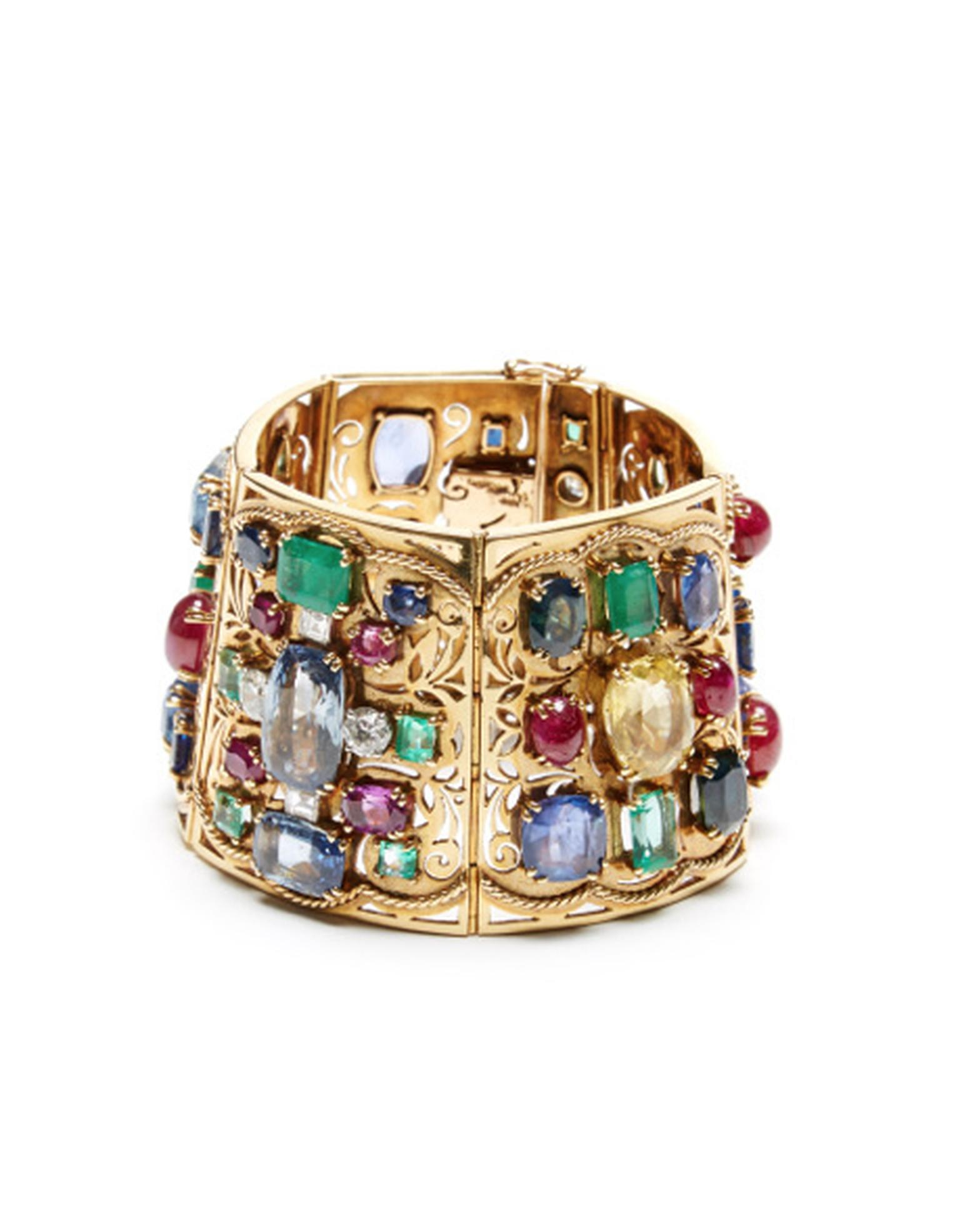 FD Gallery's Lucien Goubet bracelet from 1935 set with sapphires, rubies, emeralds and diamonds. $280,000 at Moda Operandi.
