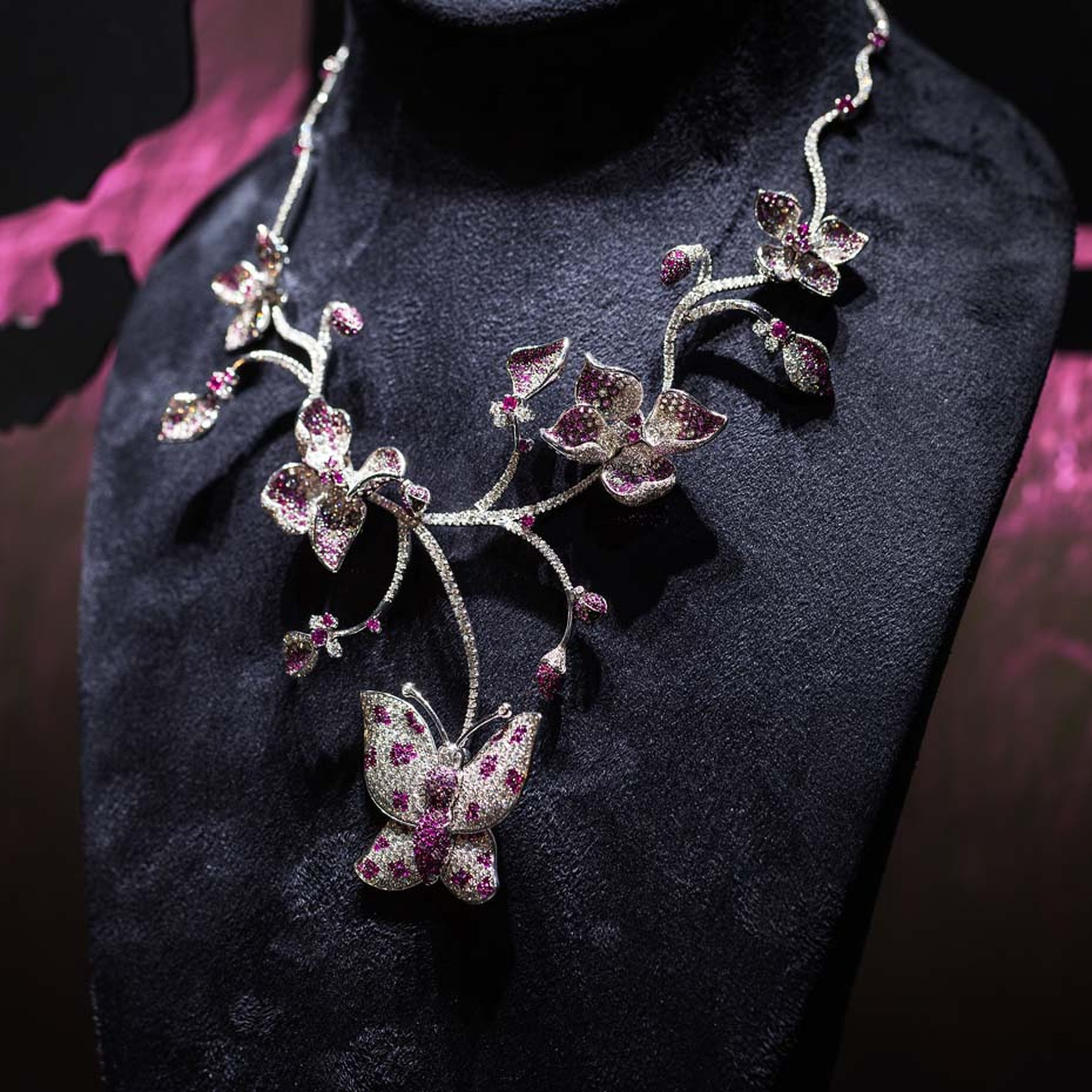 Shawish white gold Butterfly necklace with white and black diamonds and pink sapphires.