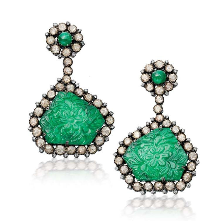 Amrapali Emerald earrings with floral carvings surrounded by diamonds.