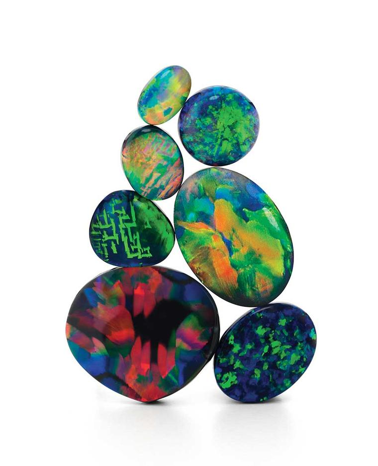 With black opals, the general rule is the darker the base and the colour bar sitting on top of it, the greater its worth per carat. Red hues are also highly prized. Photo courtesy: Giulians