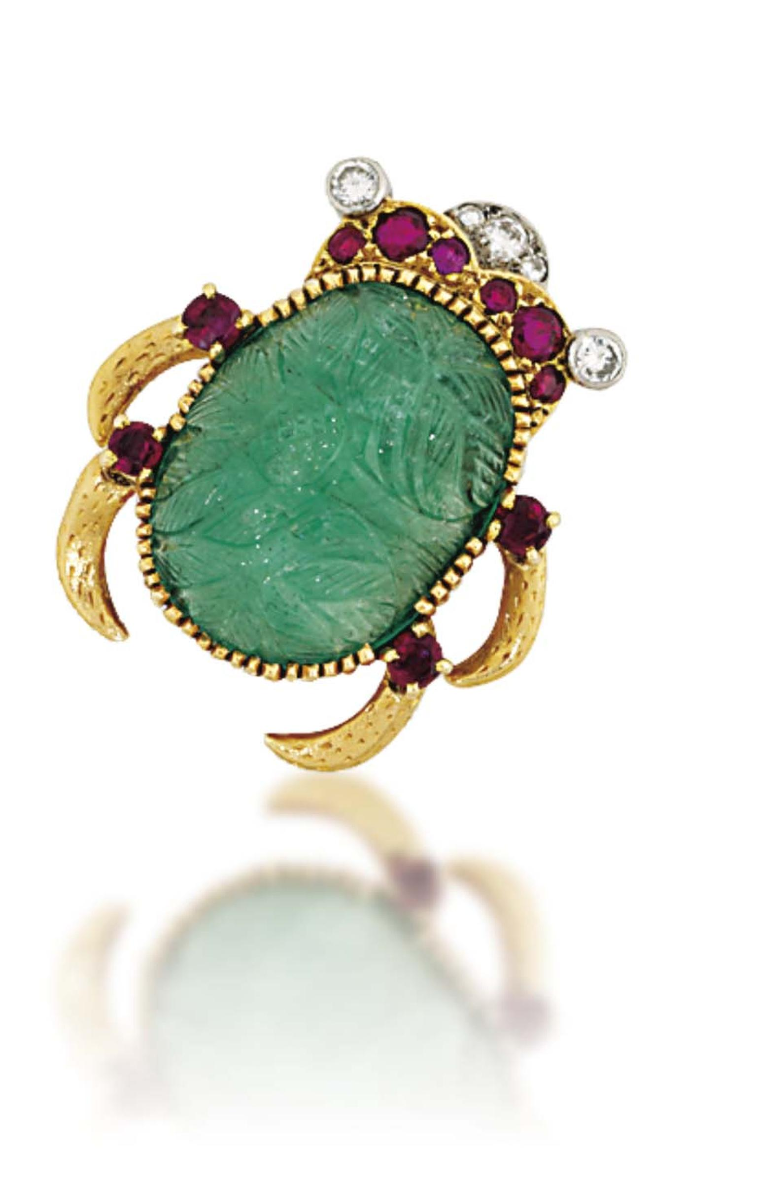 Lot 220 is an emerald, ruby and diamond Scarab brooch signed by Cartier (estimate: £8,000-12,000). Christie's Important Jewels Sale on 26 November at King Street in London.