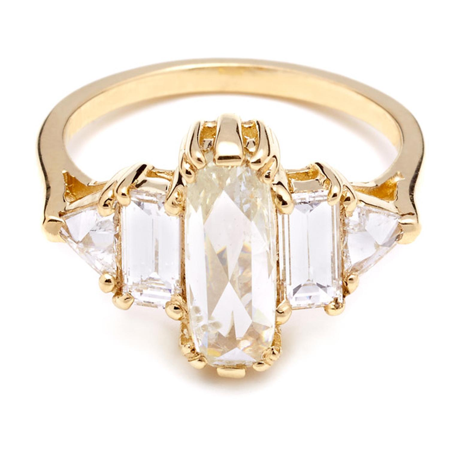 Anna Sheffield Theda ring, with a central elongated rose-cut pale yellow diamond flanked by four white diamonds in yellow gold.