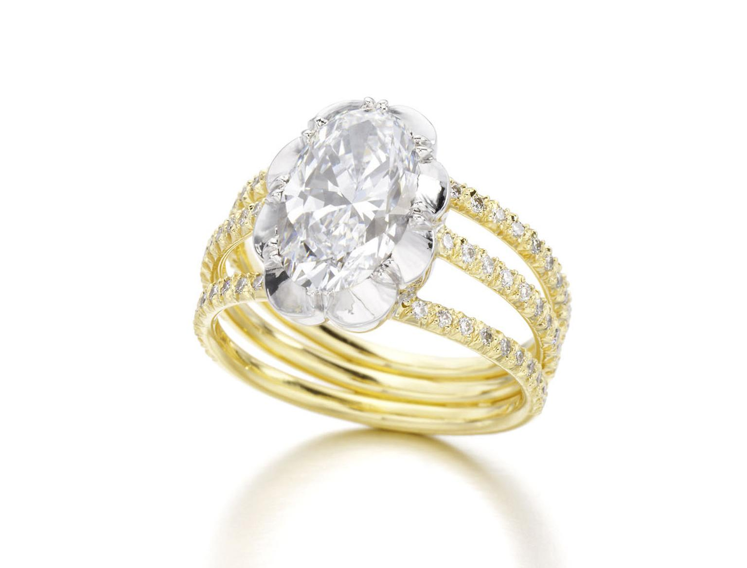 Jessica McCormack yellow gold Oval Diamond Trio ring, set with a 2.24ct oval cut diamond mounted in a Georgian style cut.