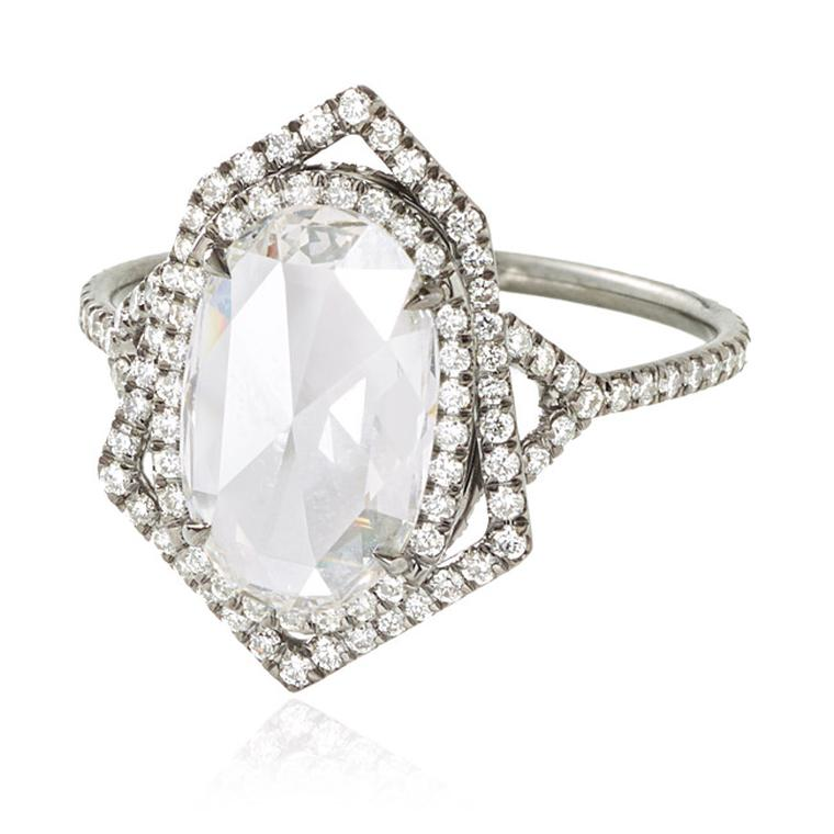 Monique Péan Mineraux collection engagement ring in recycled oxidised platinum, set with an antique white oval rose-cut diamond and diamond pavé.