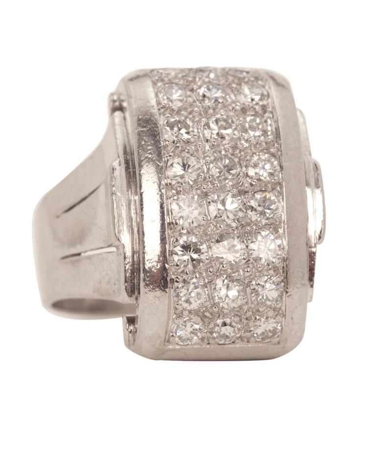 René Boivin Art Deco white gold and platinum ring circa 1935 in an odeonesque style with pavé-set diamonds.