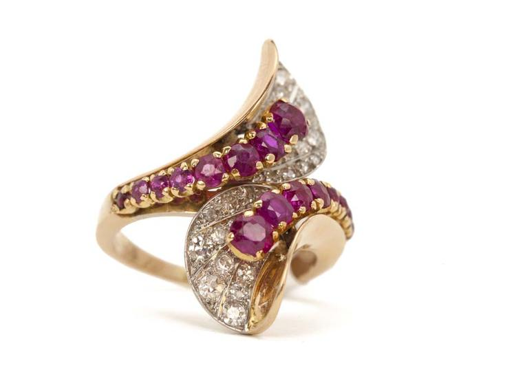 Boucheron circa 1945 yellow gold and platinum stylised crossover ring set with mixed-cut rubies and single-cut diamonds.