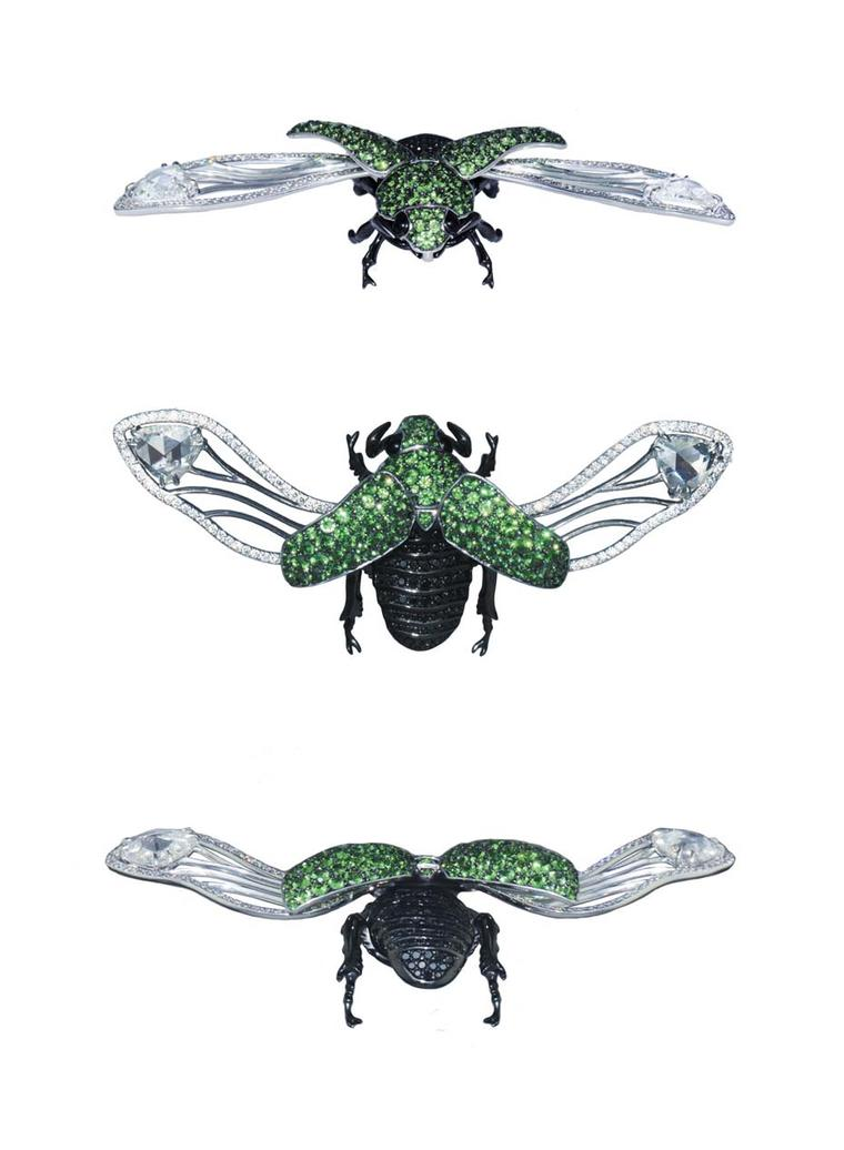 A white gold and black rhodium-plated Beetle brooch set with round black diamonds and tsavorites.