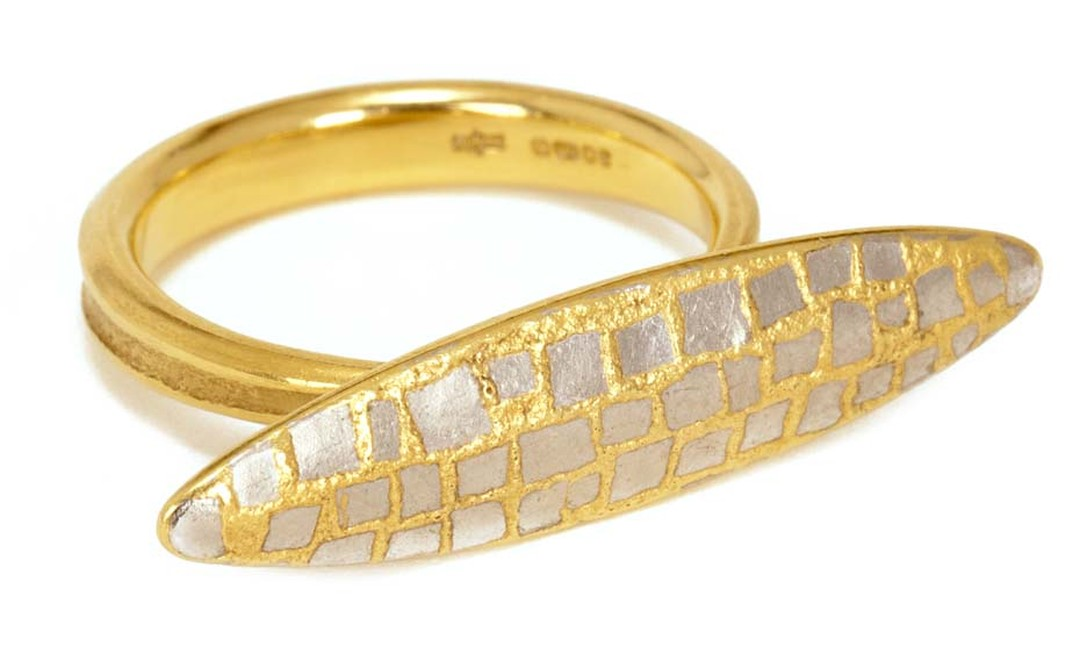 Jacqueline Mina, OBE yellow gold ring with a navette-shaped motif featuring a platinum and yellow gold tessarae design.