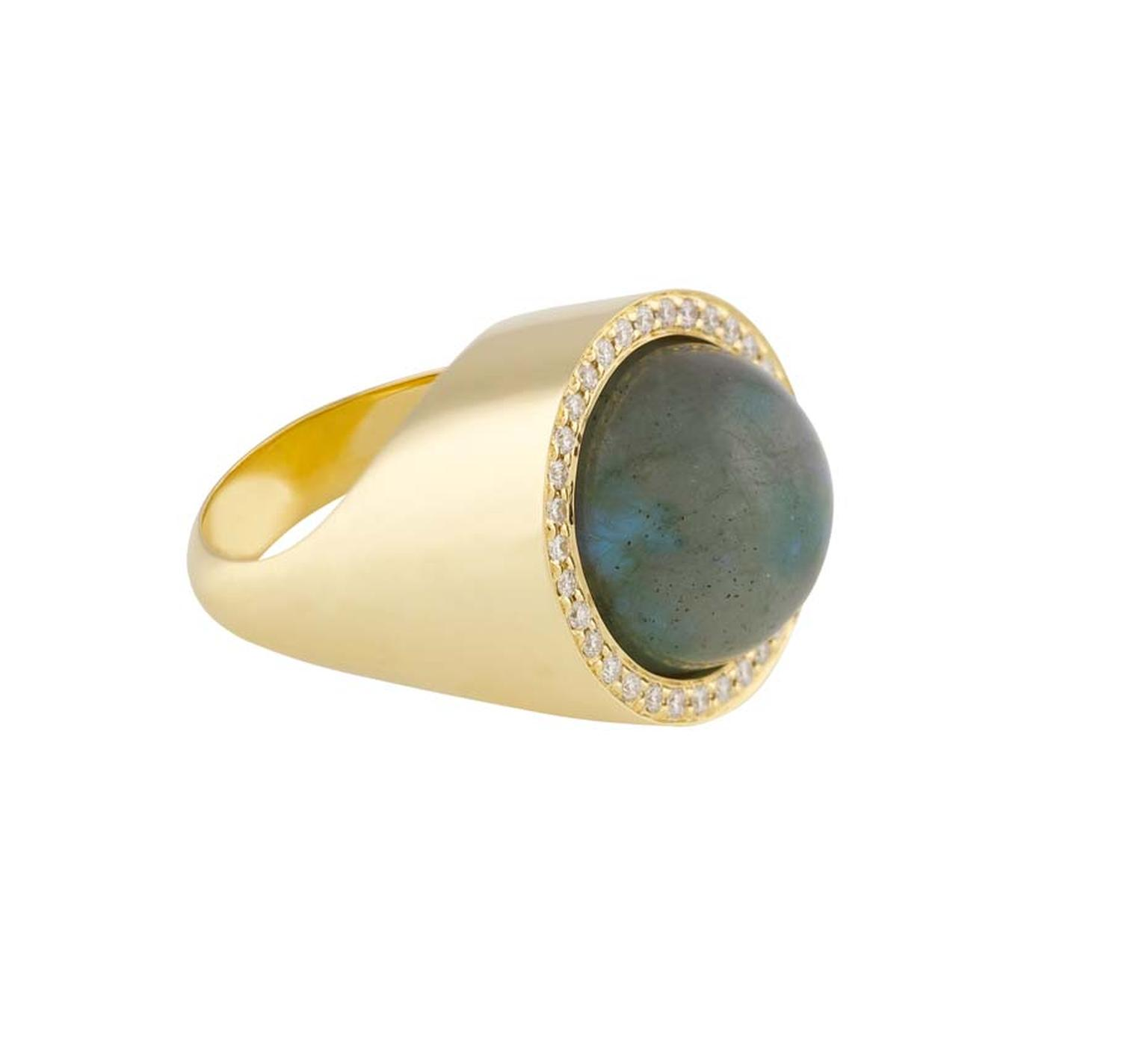 Noor Fares Aurora ring featuring a 20.15ct labradorite set in a rotating yellow gold setting with diamonds.