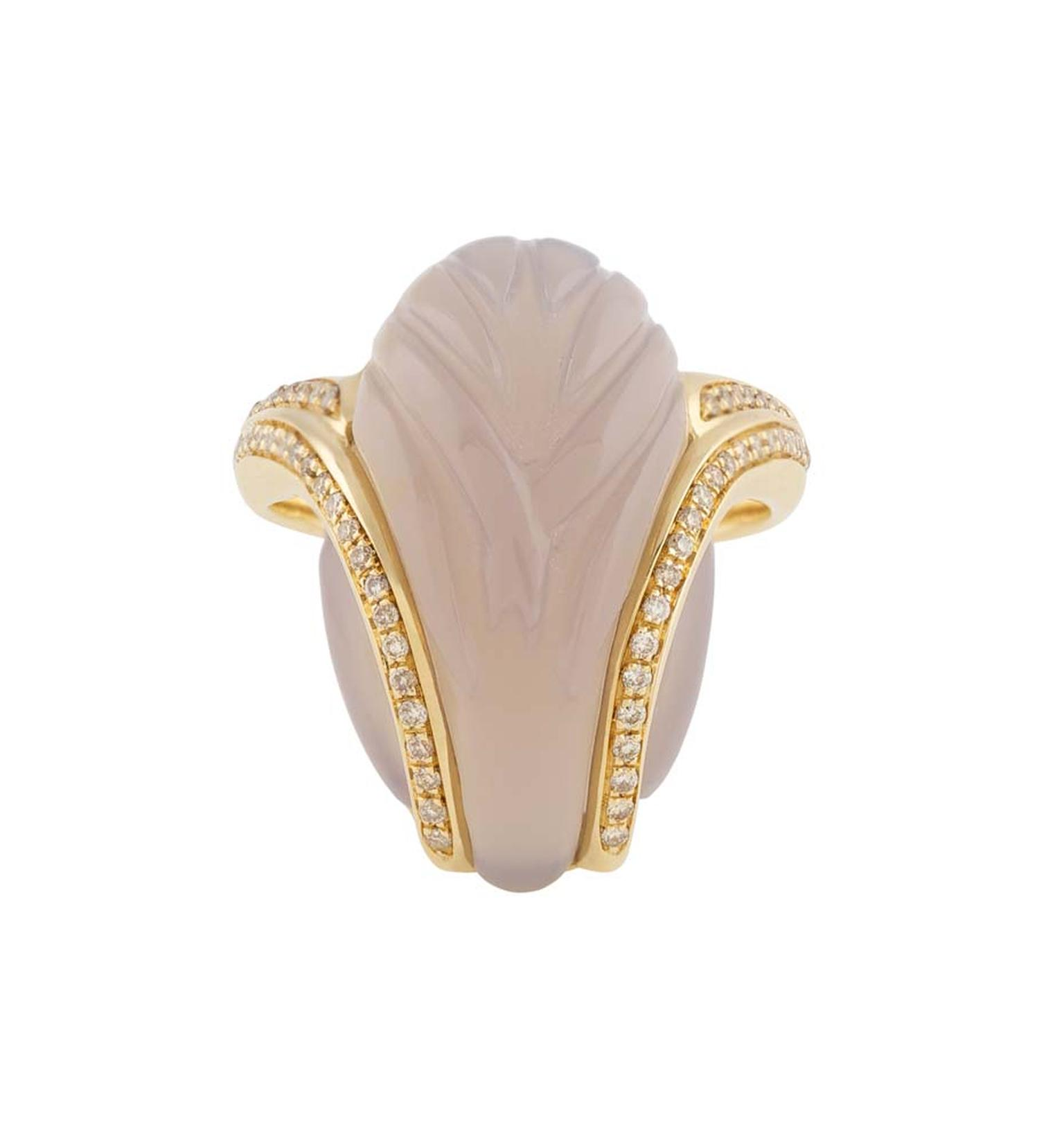 Noor Fares Fly Me to the Moon yellow gold ring with an almond-shaped mother-of-pearl stone with carved wing details and insets of diamonds with a yellow gold setting.