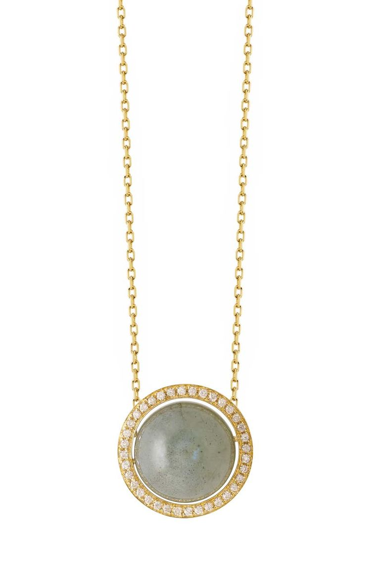Noor Fares Aurora pendant with a centre labradorite set in a yellow gold rotating axis with white diamonds.
