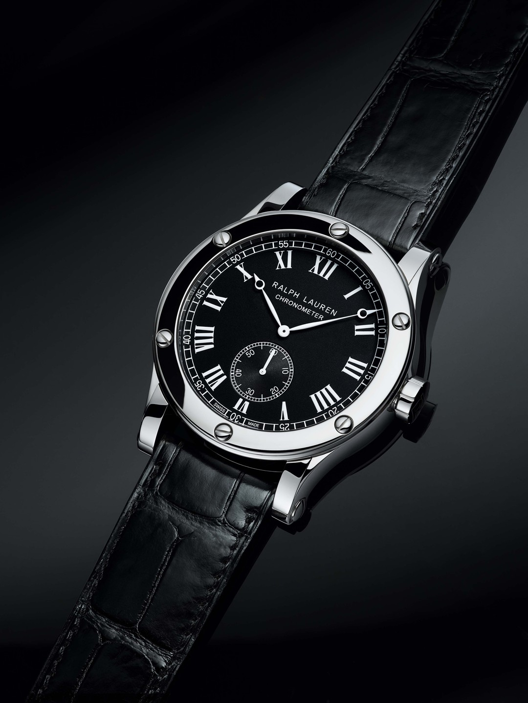 The handsome Ralph Lauren Sporting Classic Chronometer marries the elegance of a classical black tie dial with a rugged sporty feel thanks to its solid stainless steel case and riveted bezel.