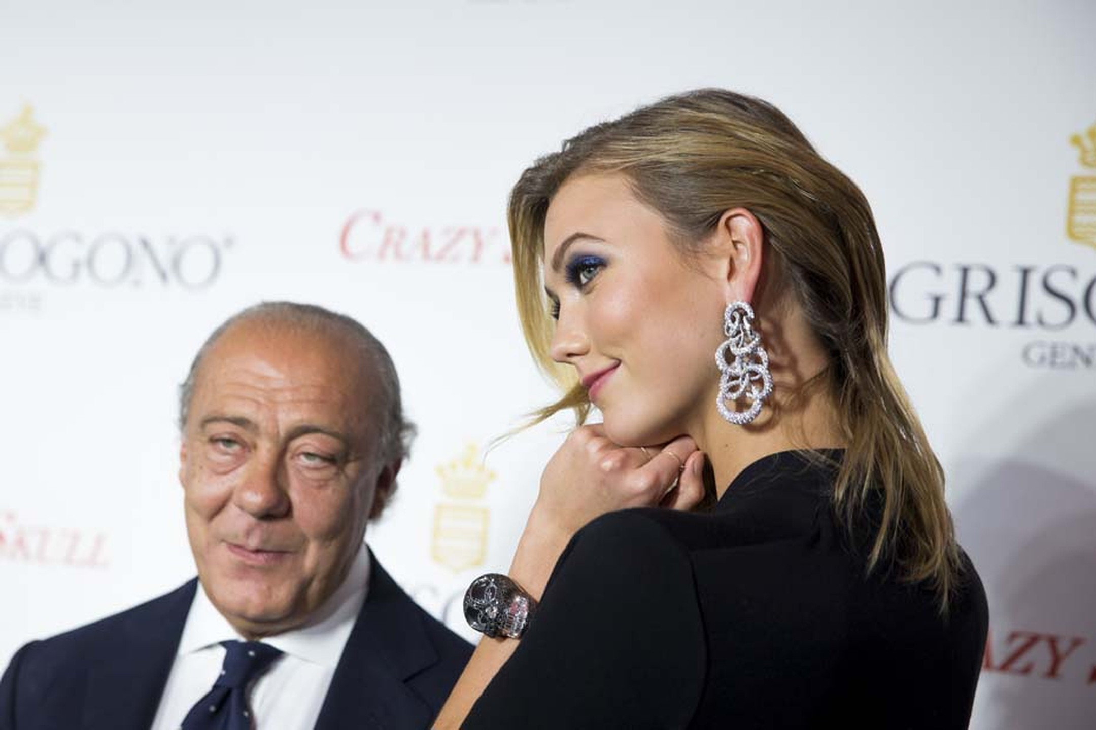 Fawaz Gruosi stands with Karlie Kloss who shows off the larger-than life Crazy Skull watch with black diamonds.