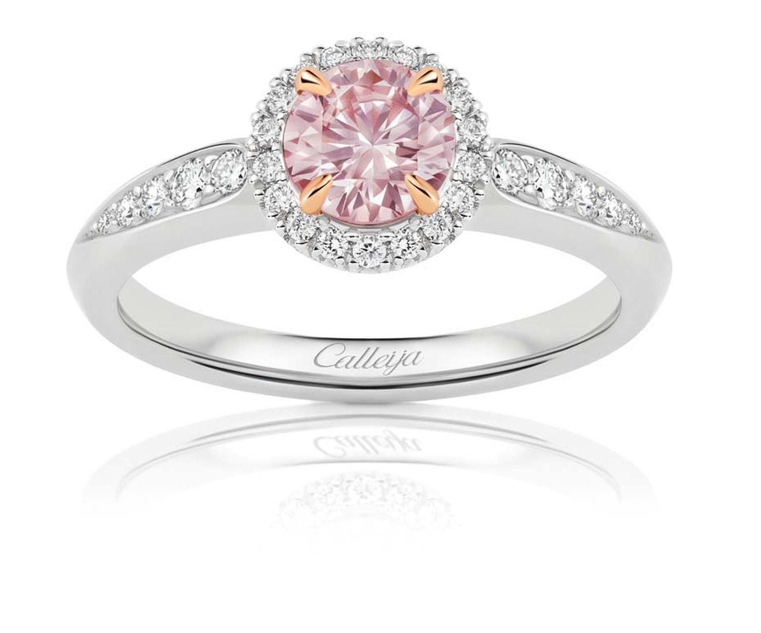 Calleija oval-cut pink diamond engagement ring featuring a pink diamond central stone surrounded by white diamonds.