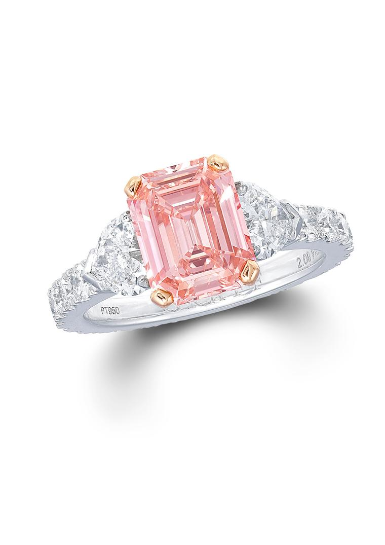 Graff emerald-cut pink diamond engagement ring with a diamond band.