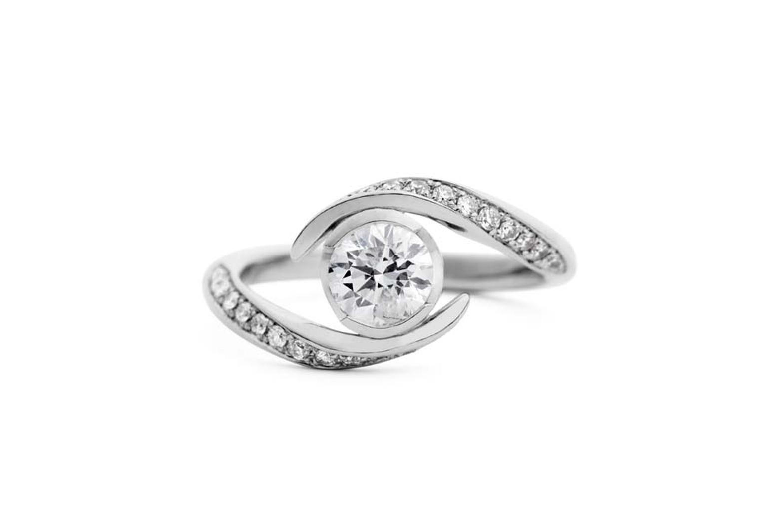 Jessica Poole Hexagon solitaire diamond engagement ring in brushed platinum with white diamonds.