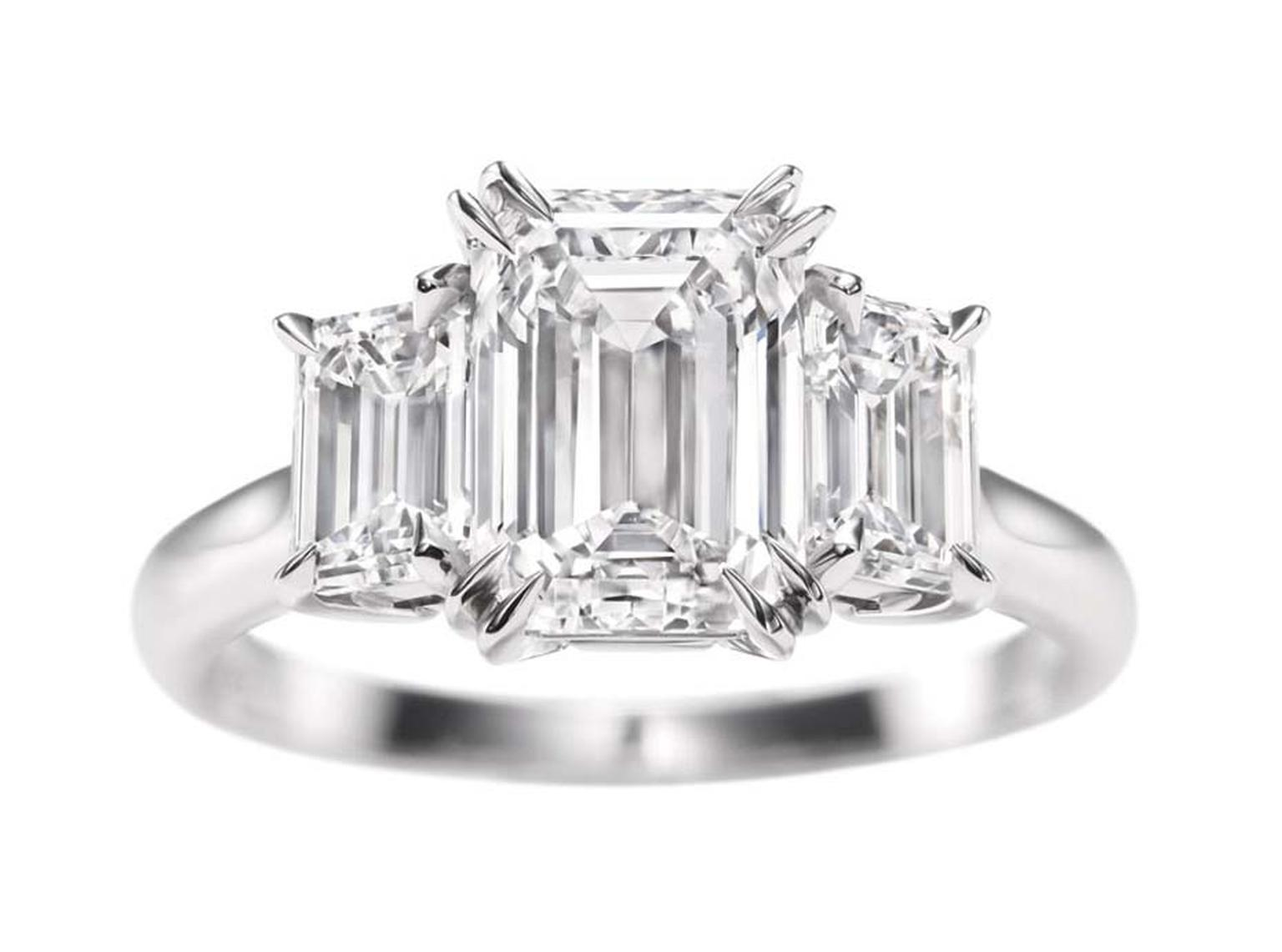 Harry Winston emerald-cut three stone diamond engagement ring.