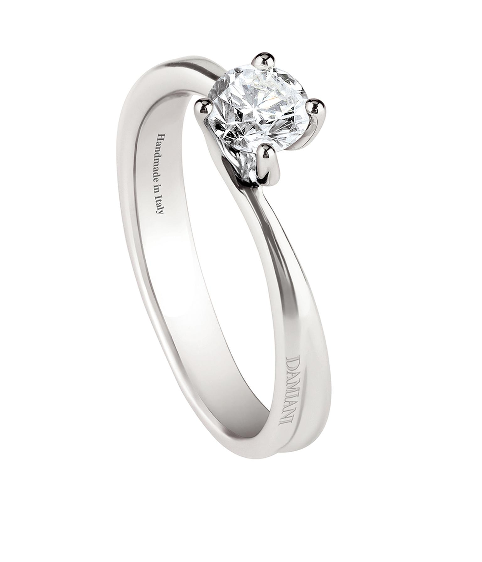 Damiani Beauty collection brilliant-cut solitaire engagement ring with a curved band setting.