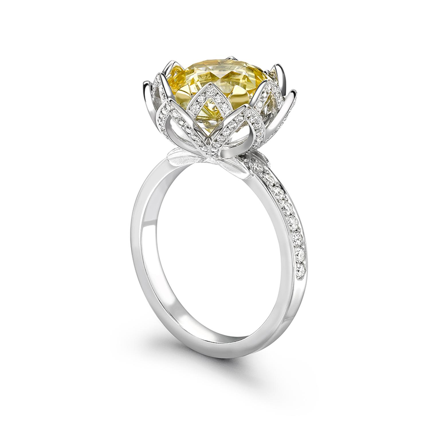 Theo Fennel Water Lily yellow sapphire engagement ring featuring a 5.88ct pale yellow sapphire enveloped in pavé diamond petals leading to the pavé band.