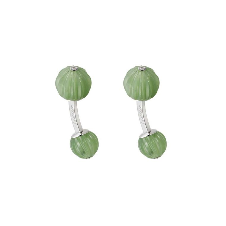 Cartier white gold cufflinks featuring sculpted jade nephrite and diamonds.