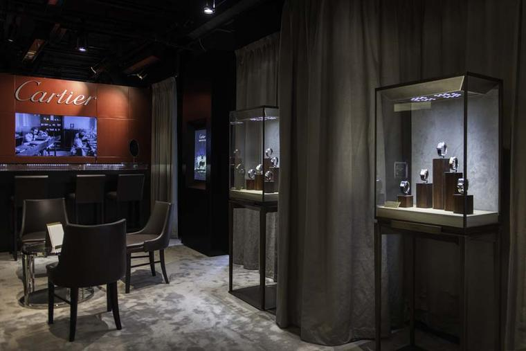 The Fine Watch Bar at The Man by Cartier pop-up salon in Harrods has the feeling of a gentleman's club with its comfortable chairs and dark wood paneling.