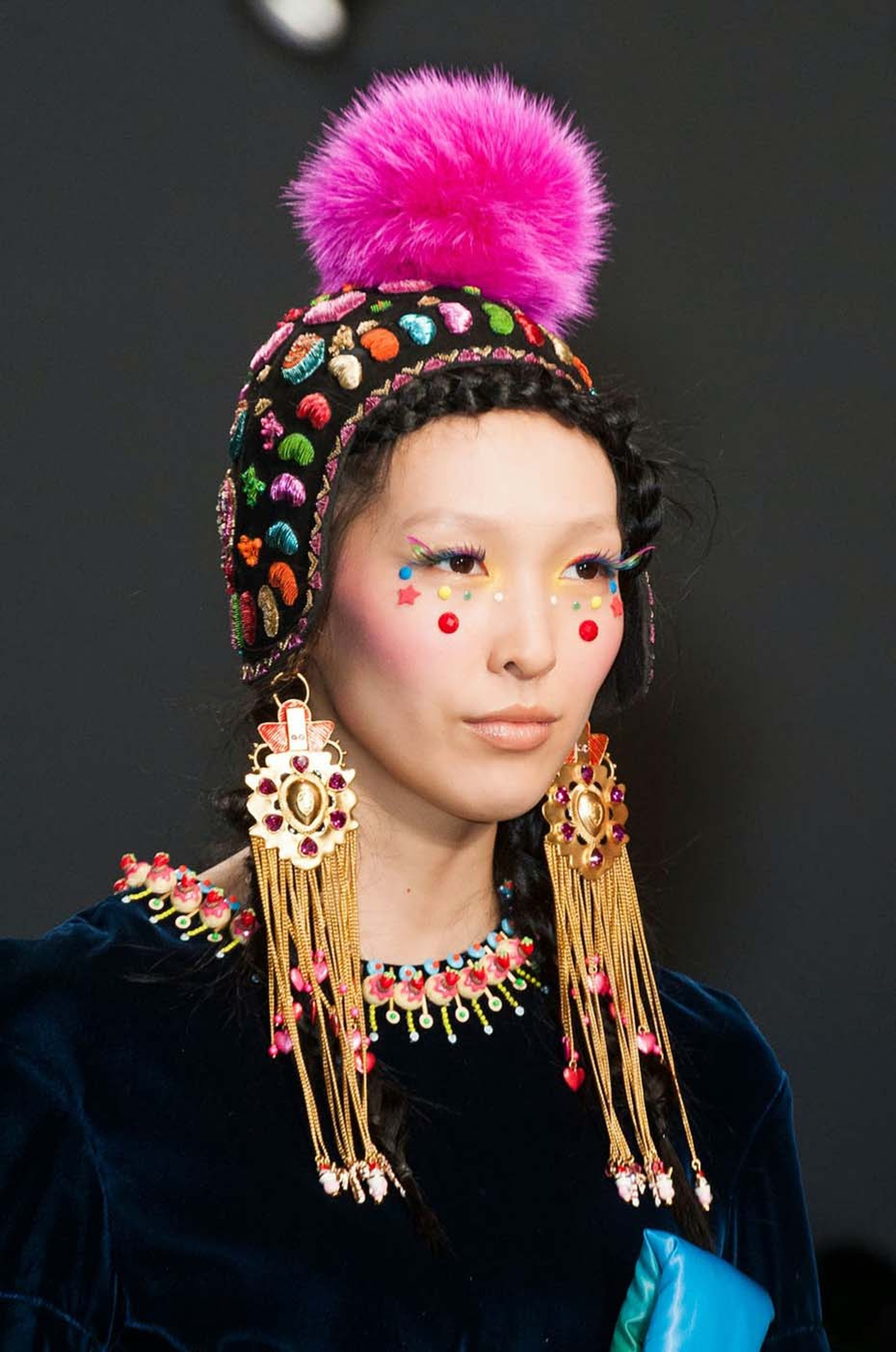 A model showcasing earrings from the Amrapali and Manish Arora AW 2014-15 collection during Paris Fashion Week.