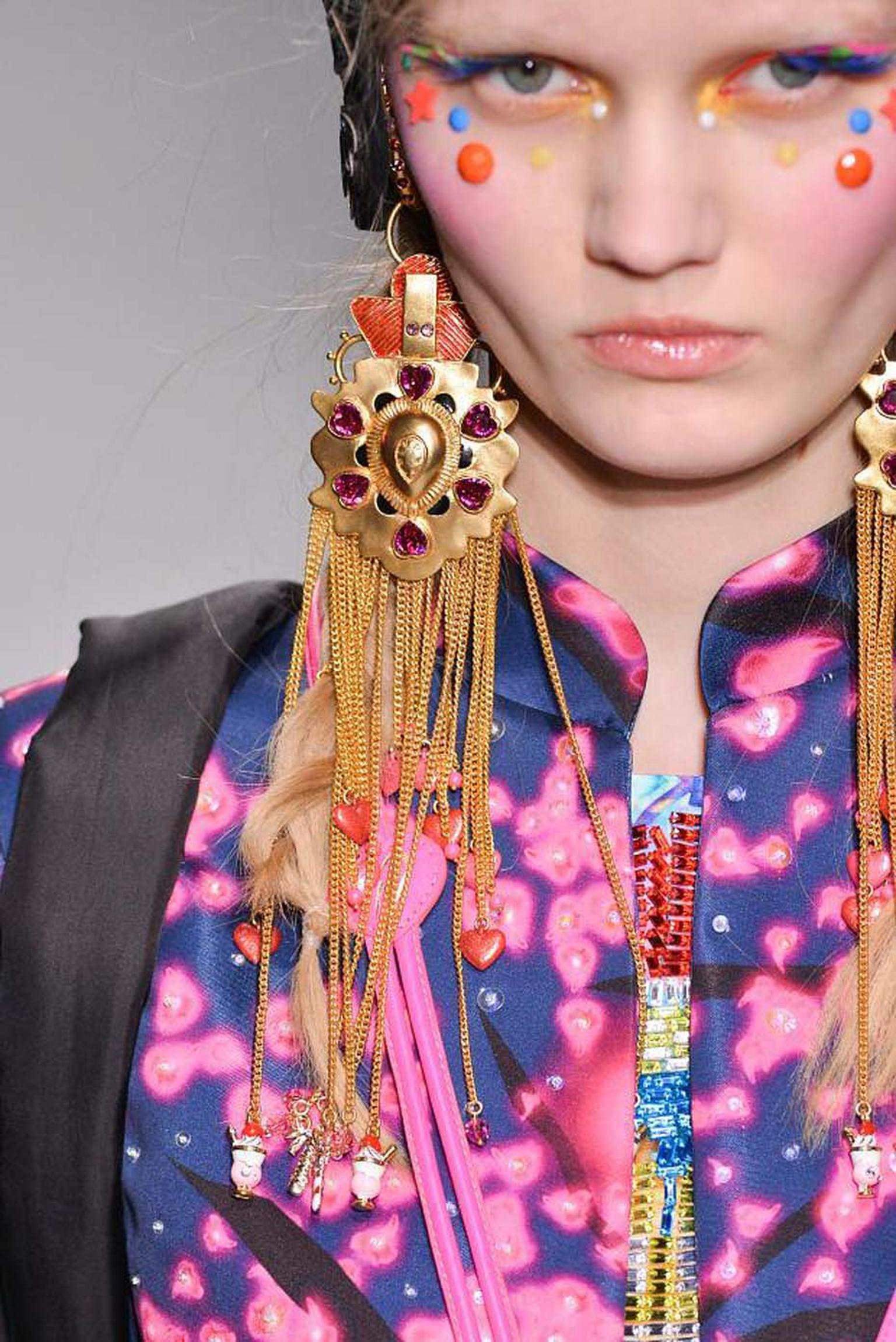 During Paris Fashion Week 2014, a model showcases earrings from the latest Amrapali and Manish Arora AW 14-15 collection.