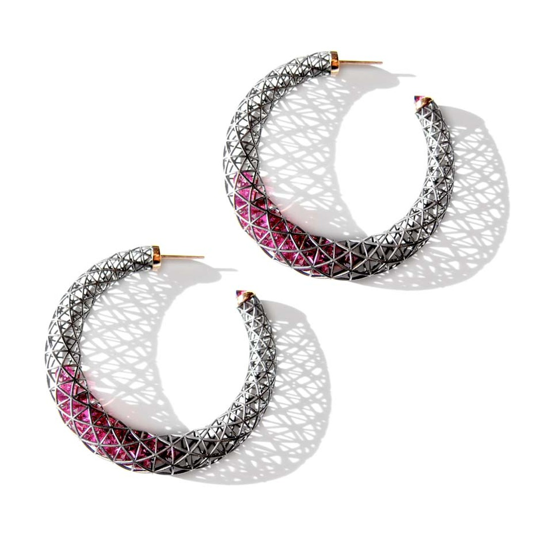 Roule & Co. crescent hoop earrings with pink tourmalines within blackened gold cages.
