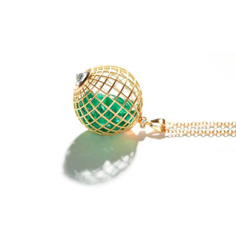 Roule & Co. yellow gold caged Globe pendant with emeralds.
