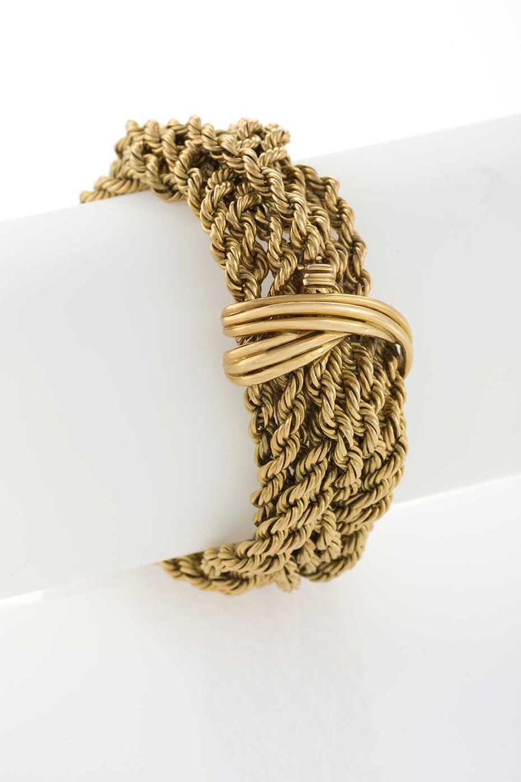 Available at Macklowe Gallery in New York is this French mid-20th century gold bracelet composed of multi strands of smaller twisted gold rope in a braided motif.
