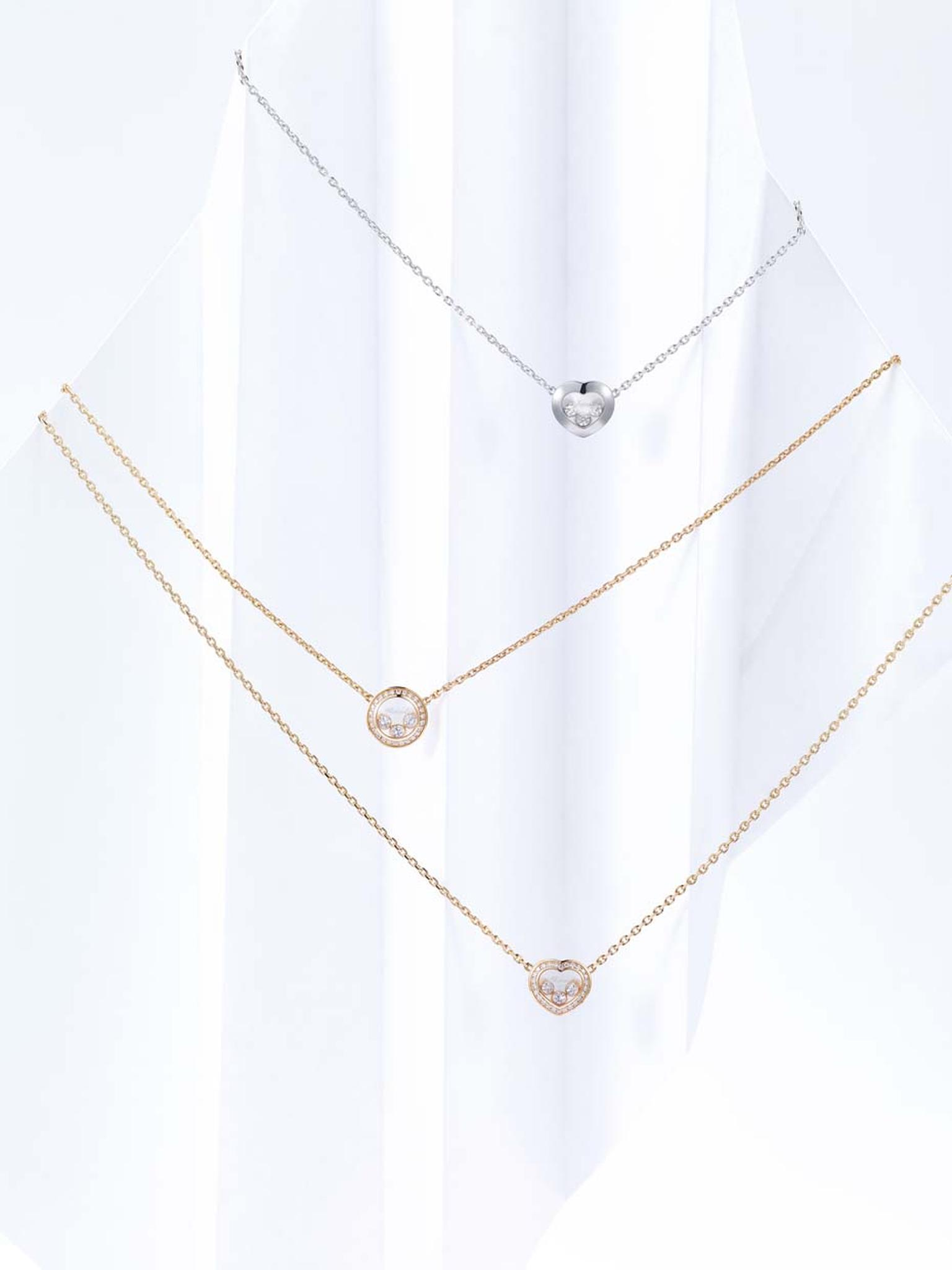 Chopard necklace from the Happy Curves collection in white or rose gold with either a circular or heart motif carrying three freely moving brilliant-cut diamonds.