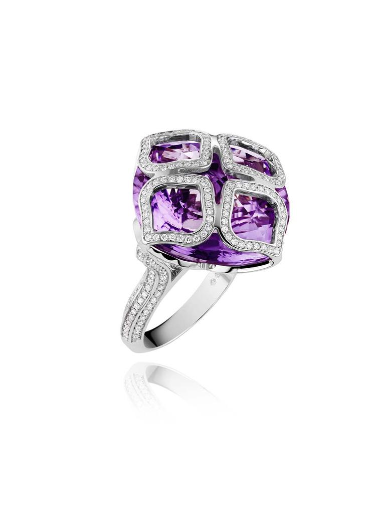 Chopard Imperiale ring featuring a faceted amethyst covered by four diamond-encrusted arabesque motifs.
