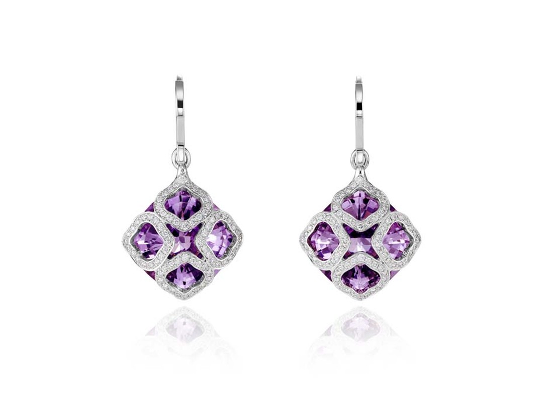 Chopard Imperiale earrings featuring faceted amethysts covered by four diamond-encrusted arabesque motifs.