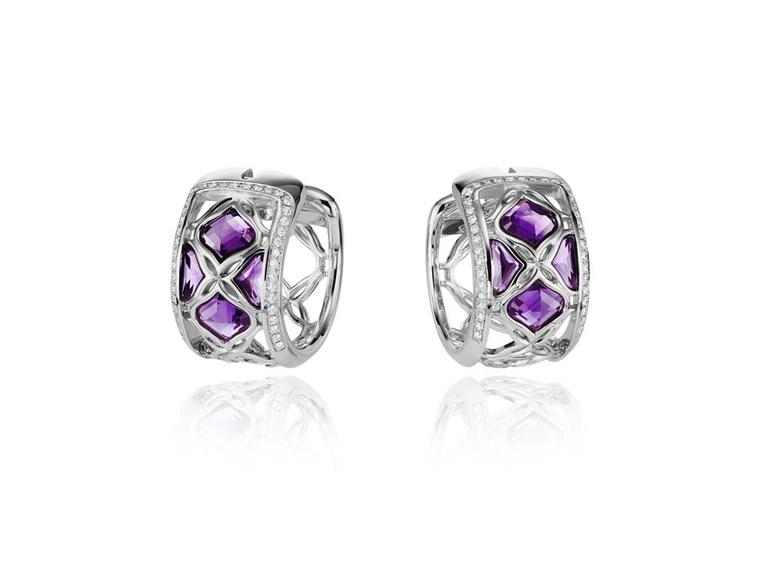 Chopard Imperiale earrings featuring faceted amethysts encompassed by diamond-encrusted arabesque motifs.