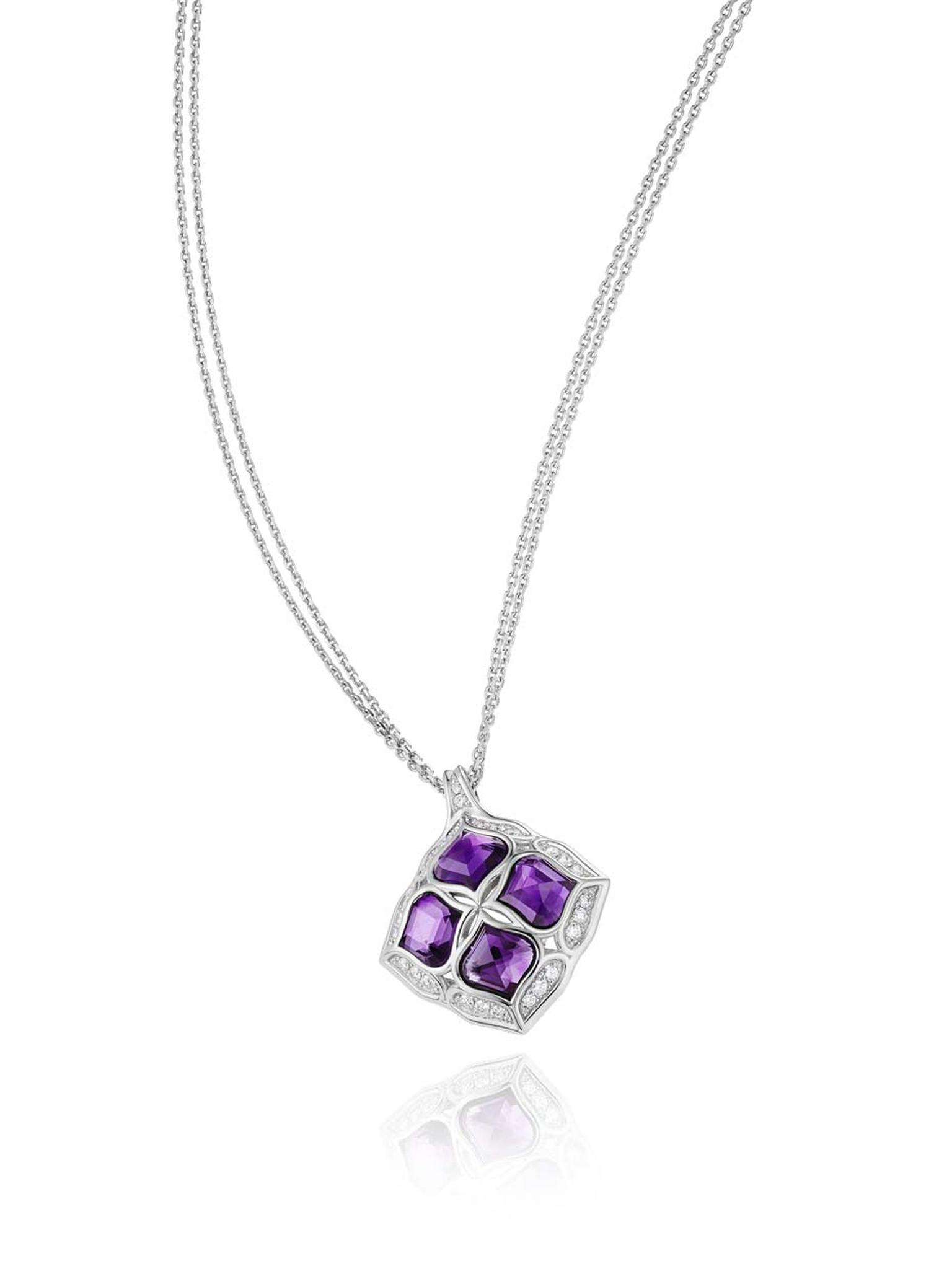 Chopard Imperiale pendant featuring a faceted amethyst surrounded by diamond-encrusted arabesque motifs.