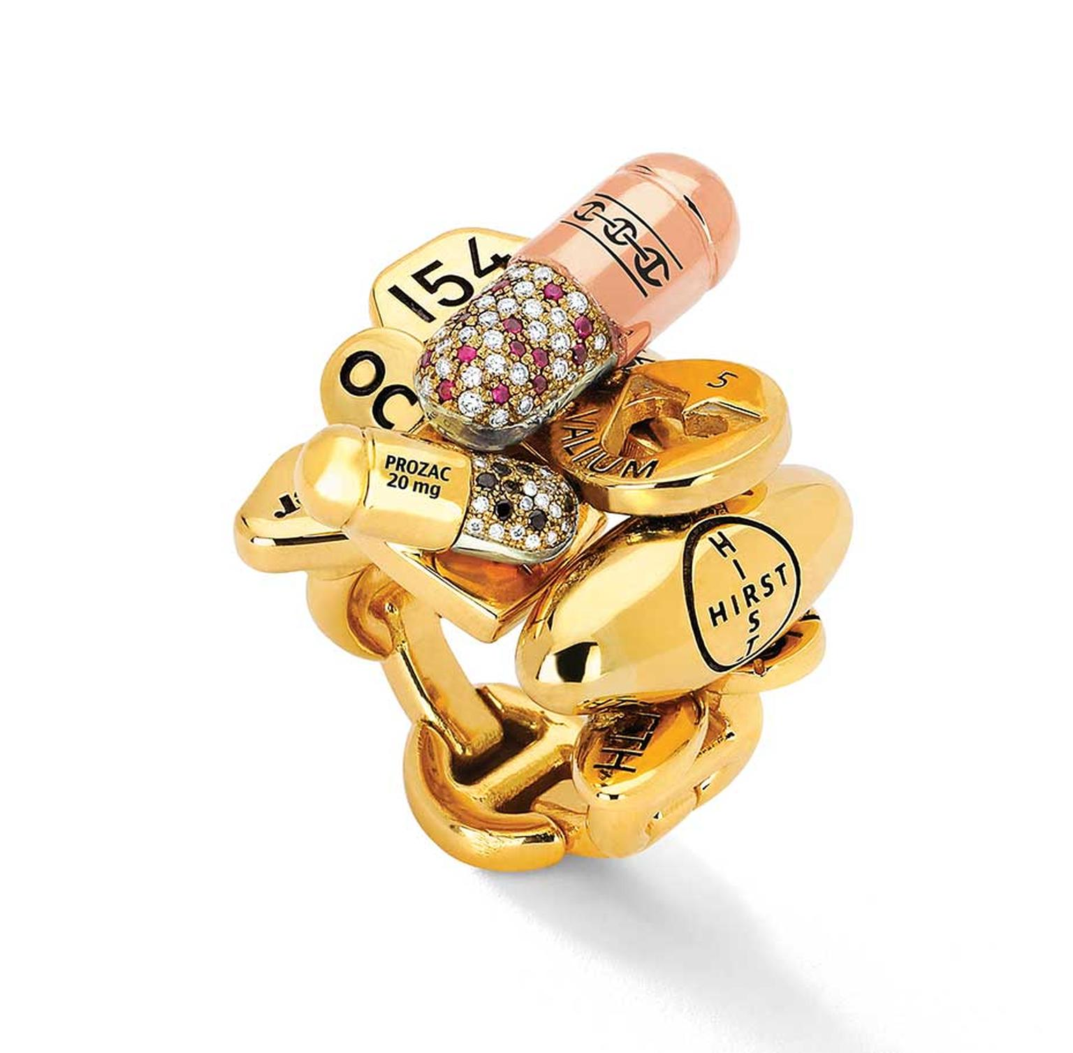 Hoorsenbuhs limited-edition Pill ring, created in collaboration with British artist Damien Hirst, colorfully mixes rose, yellow and white gold with rubies and black and white diamonds with the brand's signature links.