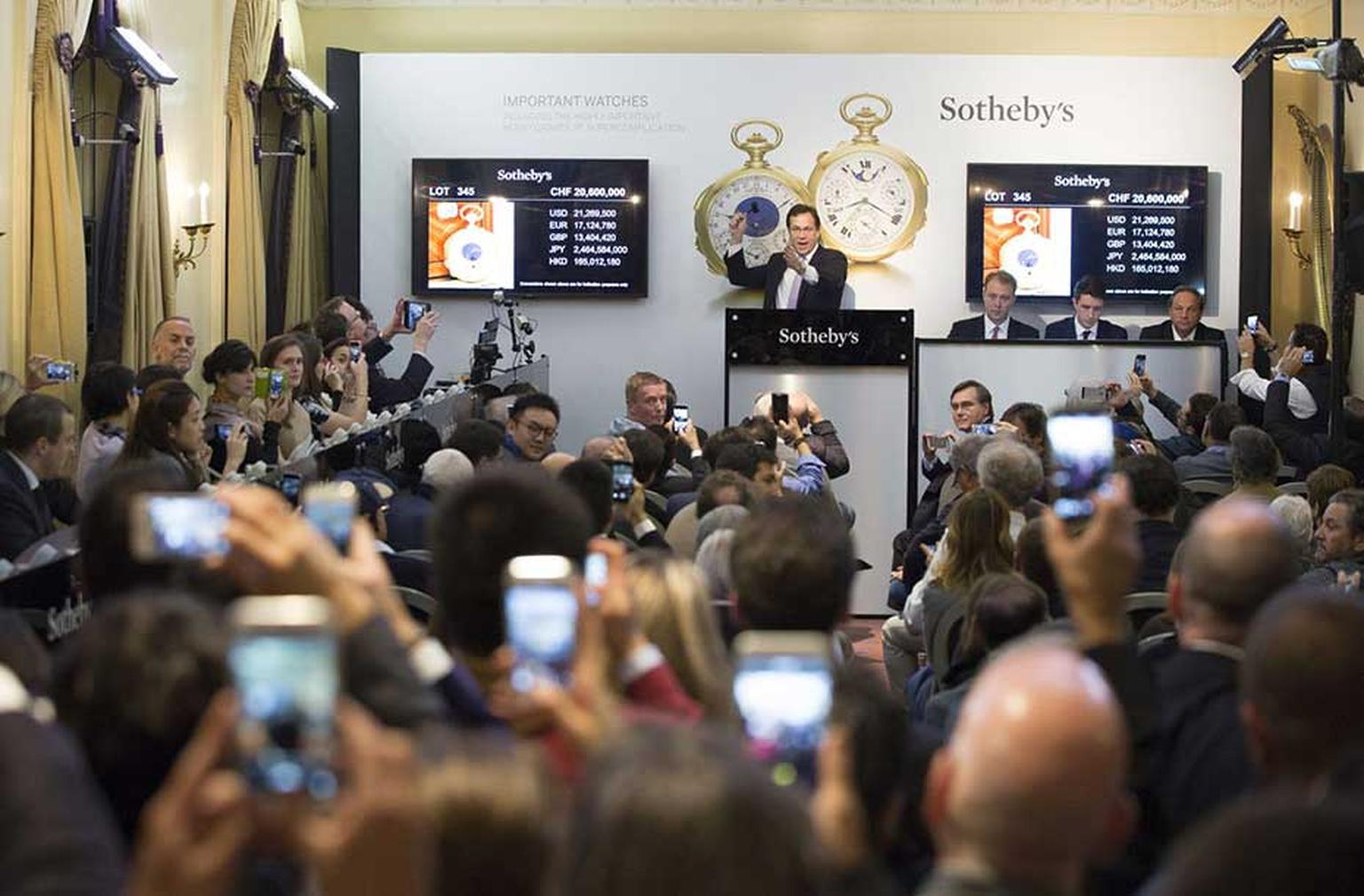The room at Sotheby's Geneva auction house erupted into wild cheering and applause as auctioneer and consultant Aurel Bacs, who spent most of the sale consulting somebody by phone, secured the Graves Supercomplication pocket watch for $24 million, making
