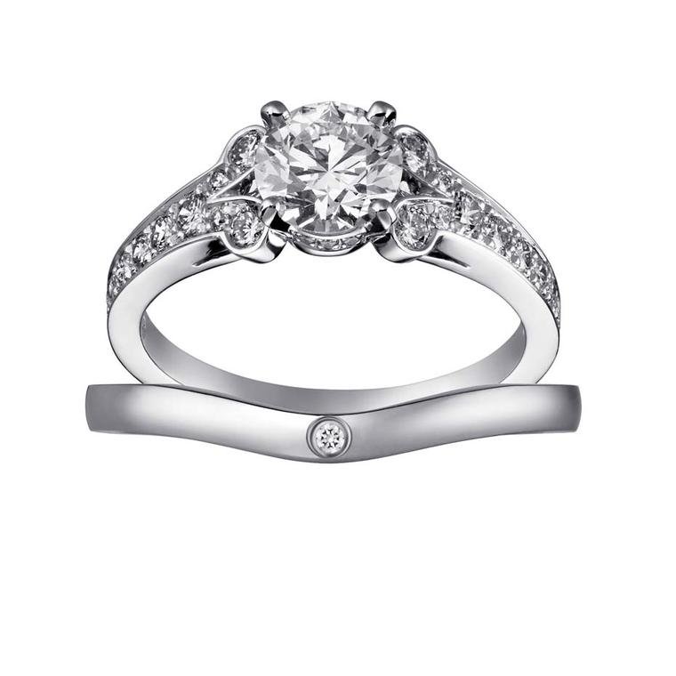 Cartier Solitaire Ballerine solitaire diamond engagement ring and band.