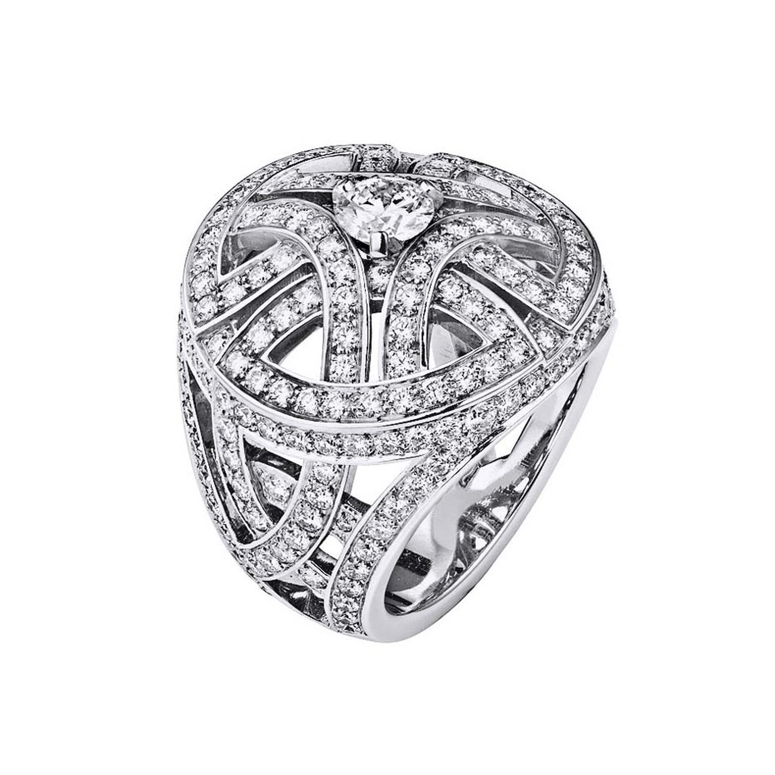 Cartier Paris Nouvelle Vague ring with arabesque motifs pavéd entirely with diamonds and set with a dazzling brilliant-cut diamond in the centre.