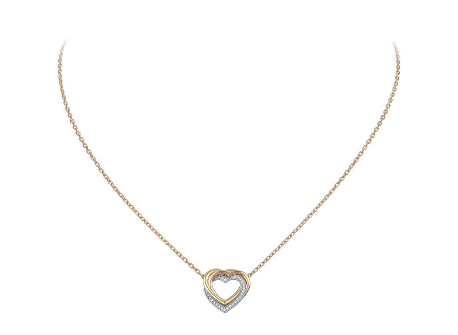 Cartier Sweet Trinity pendant with three intertwined hearts in rose and yellow gold and diamond-set grey gold.