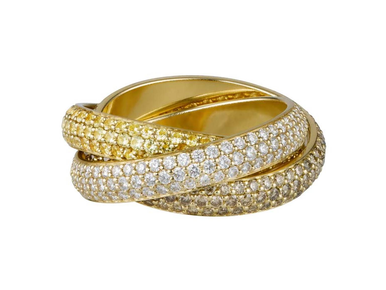 Cartier Trinity ring in rose, yellow and white gold all swathed in diamonds.