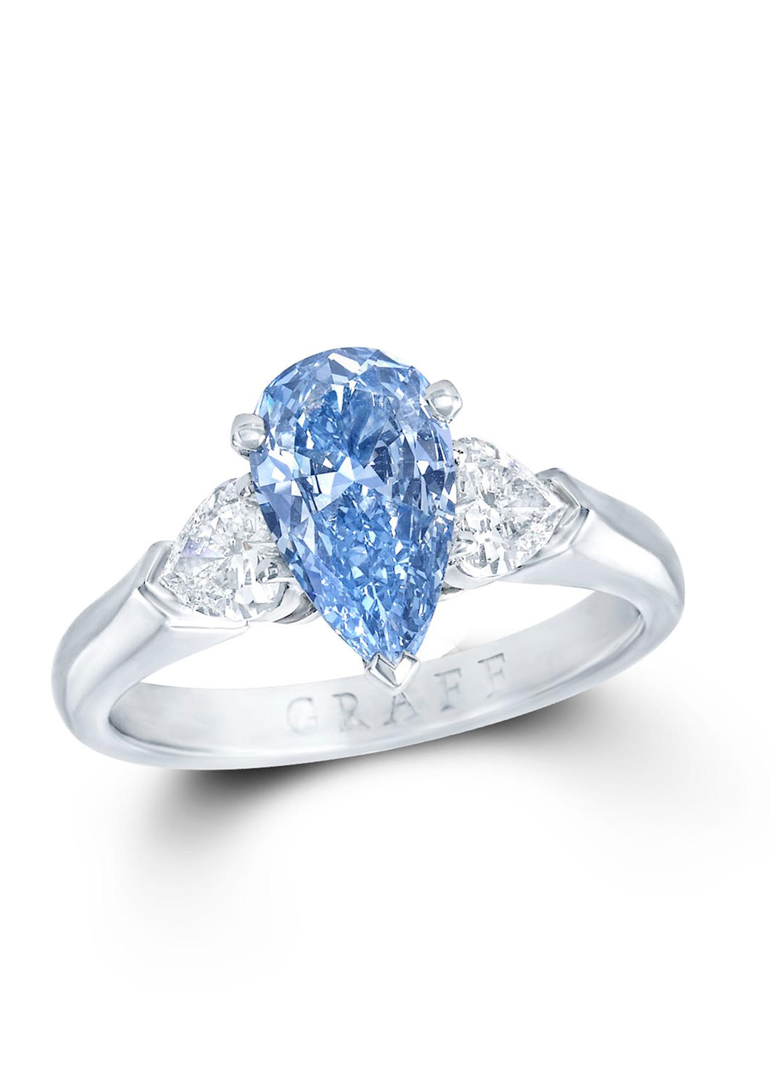 Graff 1.04ct Blue Internally Flawless diamond ring flanked by two pear-shaped white diamonds.