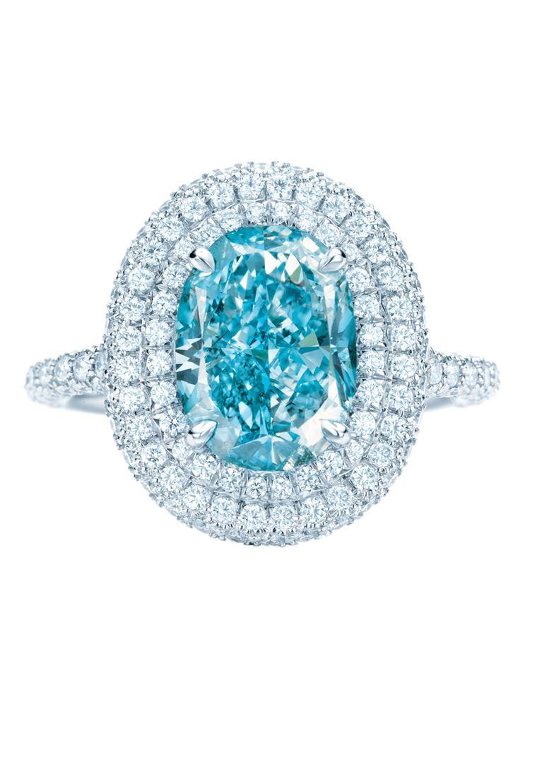 Tiffany & Co. double Halo blue diamond engagement ring encircled by pavé diamonds.