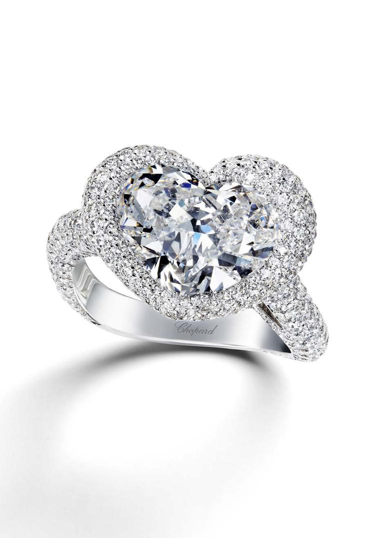 Chopard Passion for Happiness diamond engagement ring featuring a 5.63ct heart-cut diamond surrounded by smaller diamonds.