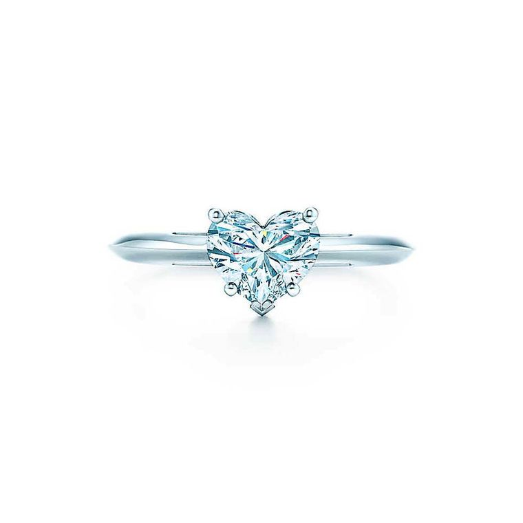 Tiffany & Co. classic diamond engagement ring with a single heart-shaped diamond.