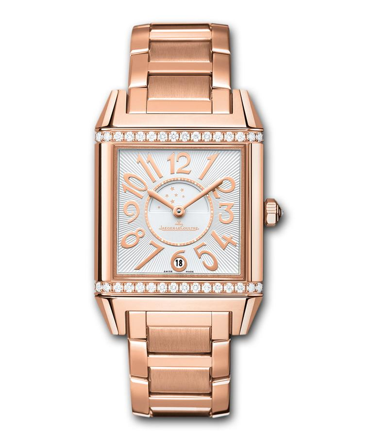 The Jaeger-LeCoultre Reverso Squadra Lady Duetto watch is just that: a square rendition of the classic rectangular Reverso. The front dial of the pink gold model features a diamond-set bezel, a silver guillochéd dial, golden numerals and a date display an