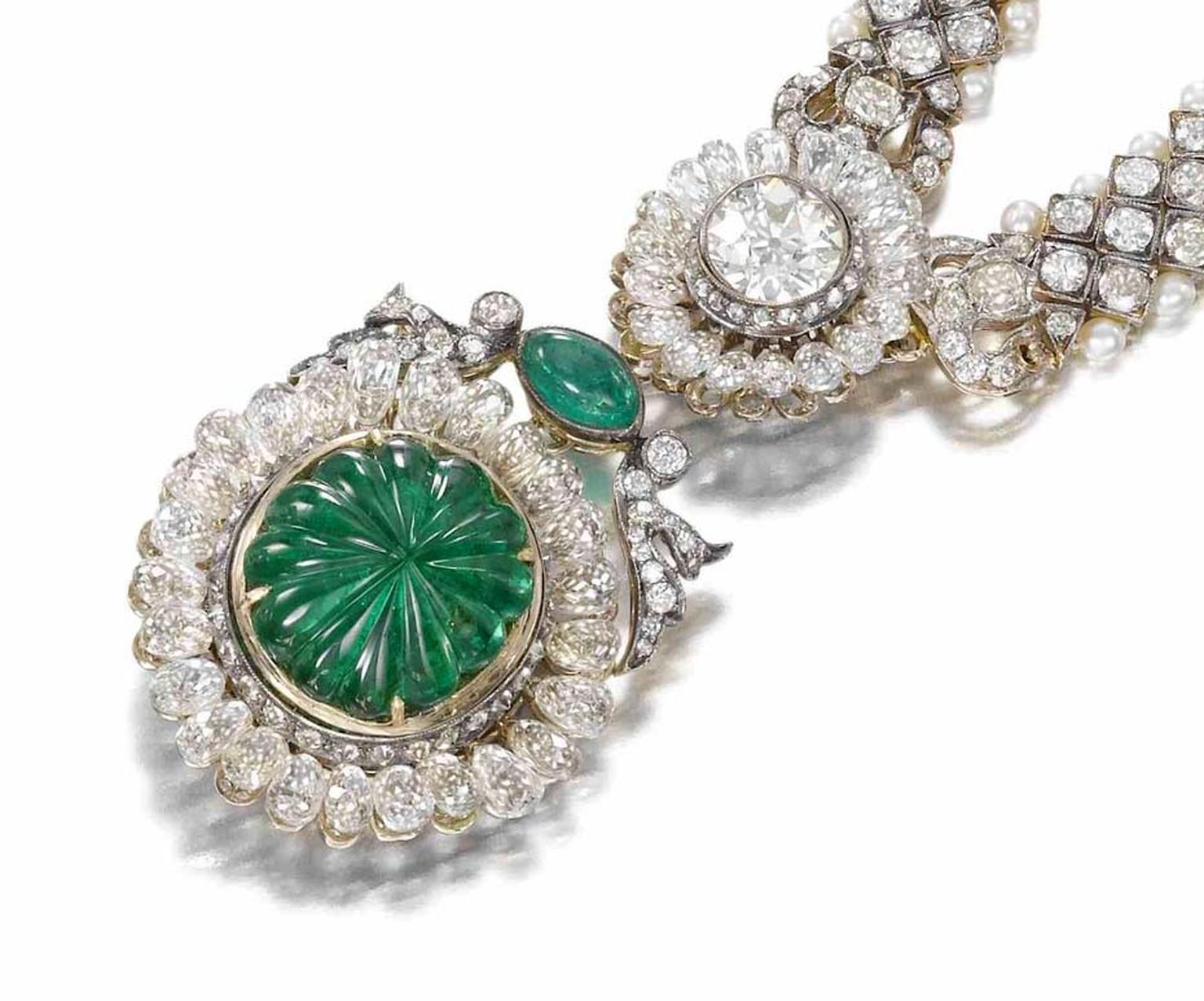 A central fluted emerald, weighing around 7.00ct, is surrounded by elongated briolette-cut diamonds that resemble the beading popular in Indian jewellery at the start of the 20th century.