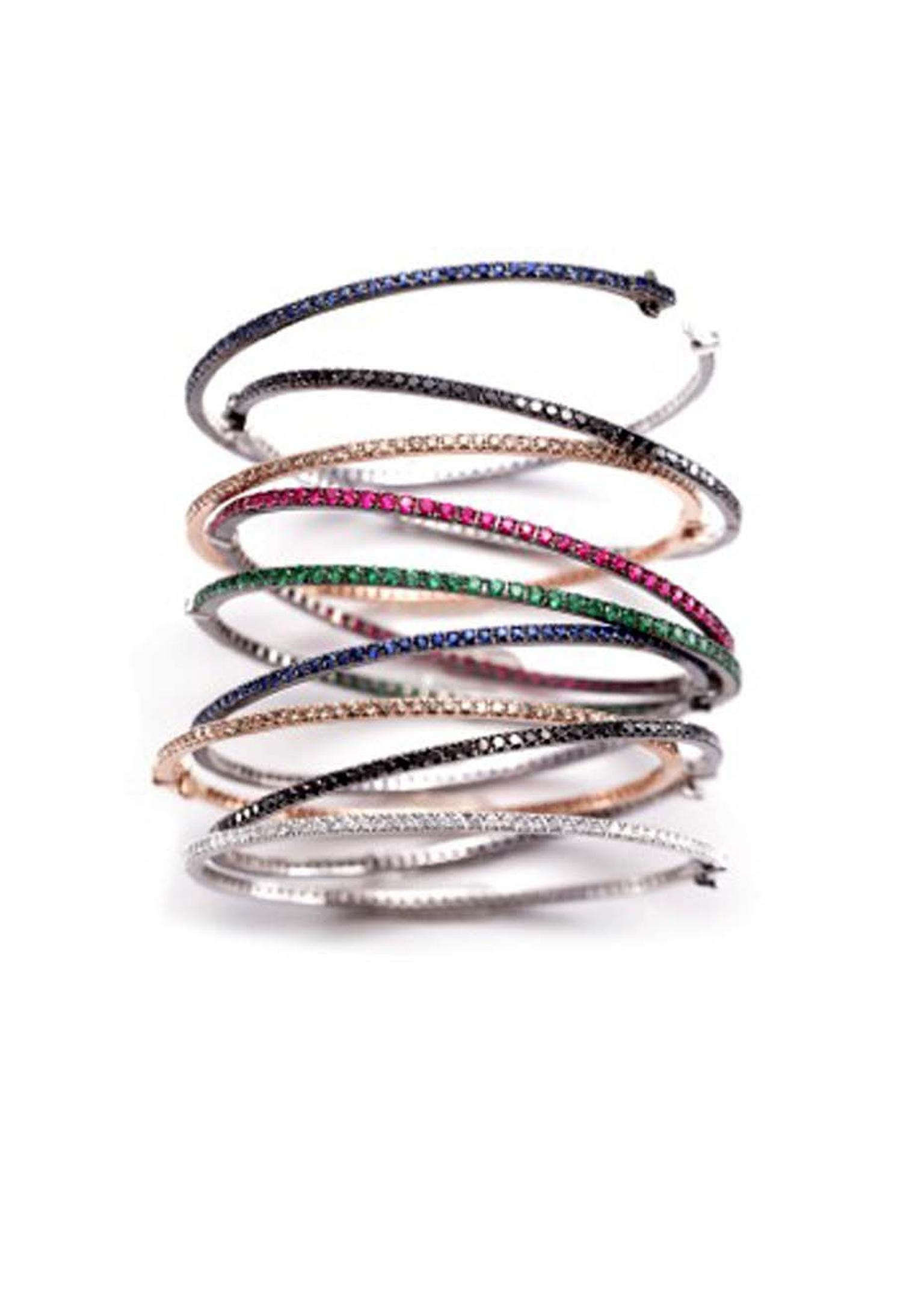 Nam Cho bangles are available in a rainbow of colours from classic white diamonds to orange, pink, purple and blue sapphires.